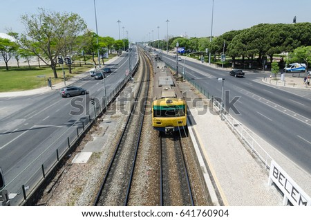 LISBON, PORTUGAL - APRIL 24: Railroad with a train at Avenida da India in the district Belem in Lisbon, Portugal on April 24, 2017