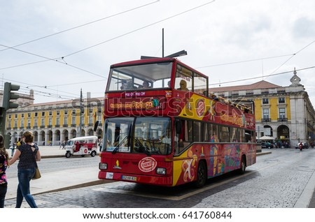 LISBON, PORTUGAL - APRIL 25: Sightseeing bus at Praca do Comercio in Lisbon, Portugal on April 25, 2017