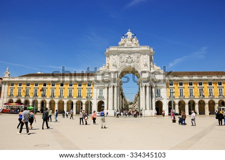 LISBON, PORTUGAL - APRIL 22, 2015: Tourists and citizens at Commerce square (Praca do Comercio) and  Rua Augusta Arch at background.