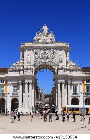 Lisbon, Portugal. April 25, Tourists explore the Praca do Comercio in front of the Triumphal Arch in the city center, on April 25, 2016 in Lisbon, Portugal. - stock photo