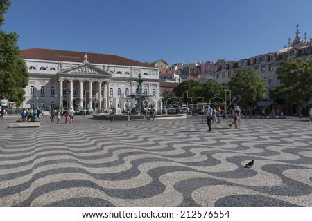 Lisbon, Portugal - August 5, 2014: Dona Maria II National Theatre and fountain in Rossio (Dom Pedro IV) Square, the main square of Lisbon