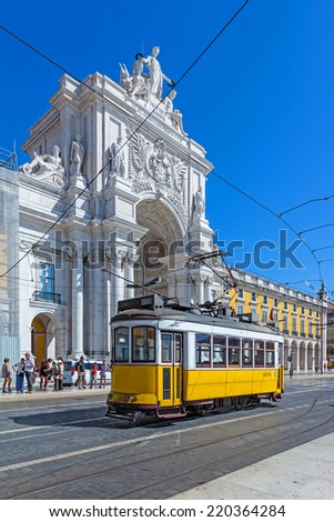 Lisbon, Portugal. August 31, 2014: Tthe iconic yellow tram in front of the Triumphal Arch that connects the Augusta Street and the Praca do Comercio Square - stock photo