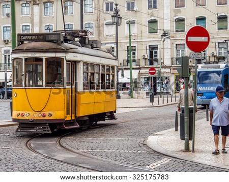 LISBON, PORTUGAL - August 24, 2012. Typical public tram in Rossie Square.