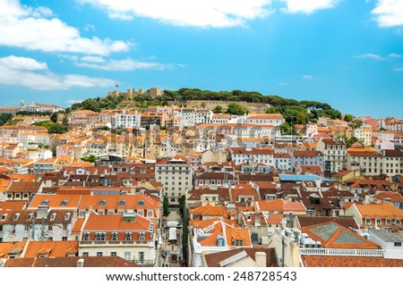 Lisbon, Portugal city skyline over Santa Justa Rua.