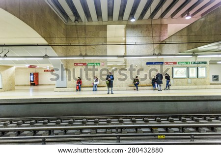 LISBON, PORTUGAL - DEC 27, 2008: people wait in the  famous Oriente metro Station for the train in Lisbon, Portugal. With  75 million passengers per year it is the largest station in Lisbon. - stock photo