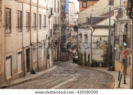 LISBON, PORTUGAL - DECEMBER 27 2015: An old tradition residents building facade with tram railway in the old Alfama quarter in Lisbon, Portugal