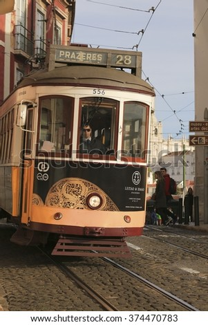 LISBON - PORTUGAL, December 24, 2015: An old traditional tram carriage in the city centre of Lisbon, Portugal. The city kept old traditional tram in service within the historical part of the capital