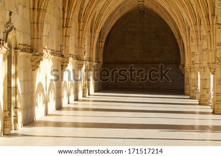 LISBON, PORTUGAL - DECEMBER 4, 2013: Detail of the cloister of the Monastery of Jeronimos, located in the district of Belem, Manueline style with Gothic and Renaissance details.