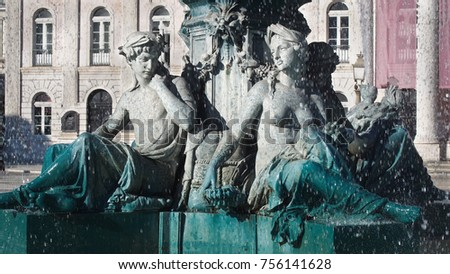LISBON, PORTUGAL-DECEMBER 21, 2017: Statues on the fountain at Rossio Square. This square is the one of Lisbon main squares since the Middle Ages.