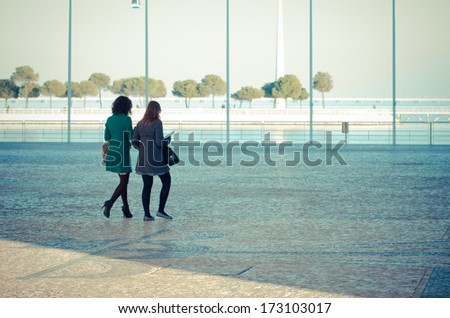 LISBON, PORTUGAL - DECEMBER 5, 2013: Two young walk on one of the esplanades, in the Park of Nations in Lisbon.