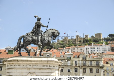 LISBON, PORTUGAL, EUROPE APRIL 15, 2010: equestrian statue of King John I in the background San Jorge Castle dominates the hill