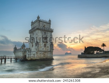 Lisbon, Portugal, Europe - view of the belem tower with a luxury cruise ship at sunset - long exposure - stock photo