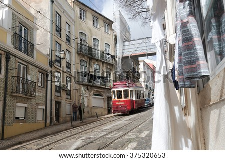 LISBON, PORTUGAL - FEBRUARY 7, 2016: Famous Old tram on street of Lisbon, capital of Portugal.