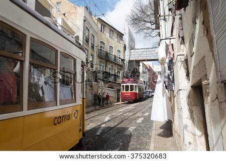LISBON, PORTUGAL - FEBRUARY 7, 2016: Famous Old trams on street of Lisbon, capital of Portugal.