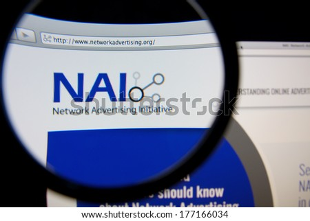 LISBON, PORTUGAL - FEBRUARY 17, 2014: Network Advertising Initiative homepage through a magnifying glass. NAI is an industry trade group that develops self-regulatory standards for online advertising.