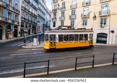 LISBON, PORTUGAL - FEBRUARY 03, 2016: Old Lisbon street and traditional yellow tram, Portugal