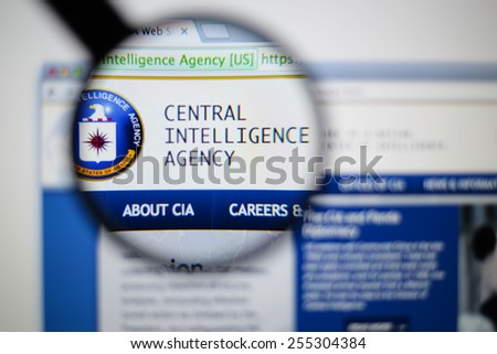 LISBON, PORTUGAL - February 24, 2015: Photo of cia central intelligence agency. page on a monitor screen through a magnifying glass. - stock photo