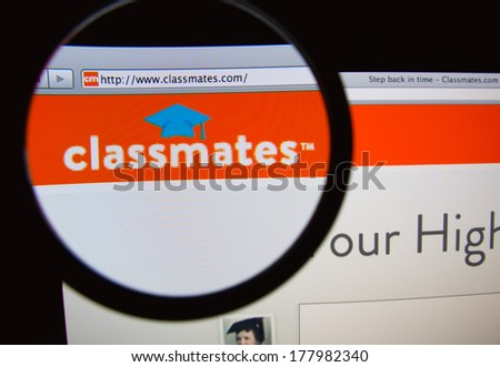 LISBON, PORTUGAL - FEBRUARY 21, 2014: Photo of Classmates.com homepage on a monitor screen through a magnifying glass. - stock photo