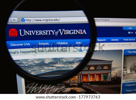 LISBON, PORTUGAL - FEBRUARY 21, 2014: Photo of the University of Virginia homepage on a monitor screen through a magnifying glass.