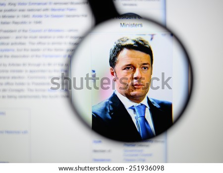 LISBON, PORTUGAL - February 12, 2015: Photo of Wikipedia article page about Matteo Renzi on a monitor screen through a magnifying glass. - stock photo