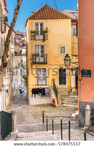 LISBON, PORTUGAL - FEBRUARY 8: typical urban view of Loureiro street with the residential building located in the historical district of Alfama in Lisbon, Portugal on February 8, 2017.