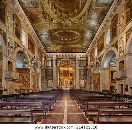LISBON, PORTUGAL - JULY 25: Symmetrical composition of rich decorated interior of church museum of Sa Roque , on July 25, 2014 in Lisbon, Portugal. - stock photo