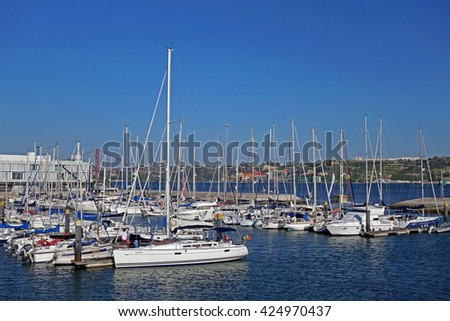 LISBON, PORTUGAL - JUNE 17, 2015: Boats and yachts parked at port of Belem during a hot summer day