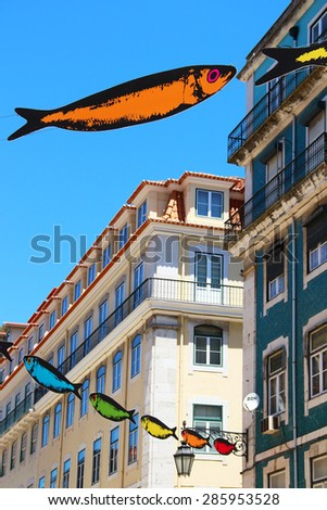 LISBON, PORTUGAL- JUNE 12, 2013: Central street of Lisbon decorated with sardines during Popular Saints Festival (Festas dos Santos Populare) - stock photo