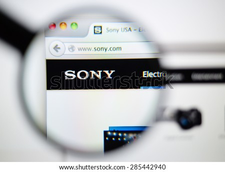 LISBON, PORTUGAL - June 6, 2015: Photo of: www.sony.com, sony homepage on a monitor screen through a magnifying glass. - stock photo