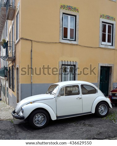 LISBON, PORTUGAL - MARCH 06, 2016:  Classic White Volkswagen Beetle motorcar in the streets of the Estrela district of Lisbon Portugal. - stock photo