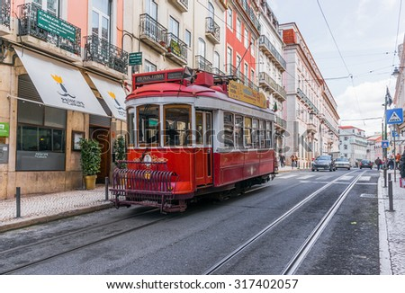 LISBON, PORTUGAL- MARCH 23, 2013: Historic classic red tram of Lisbon built partially of wood