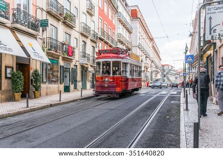 Lisbon, Portugal March 24, 2013: Historic yellow tram in front of the Lisbon