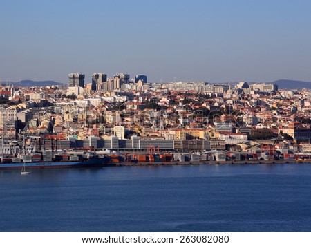 LISBON, PORTUGAL - MARCH 06: Panoramic view of Lisbon skyline, docks and the Tagus River taken from The Cristo Rei Sanctuary in Almada on the Southern margin. On March 06, 2015 in Lisbon, Portugal.  - stock photo