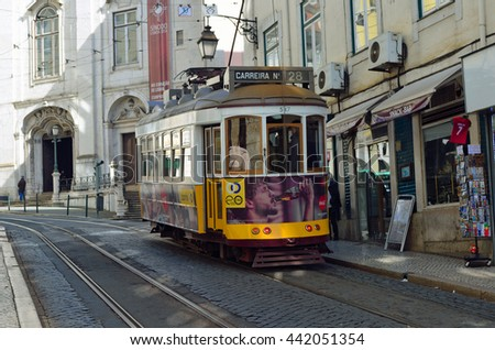 LISBON, PORTUGAL - MARCH 07, 2016: Vintage Yellow Tram on the streets of Alfama Lisbon Portugal.