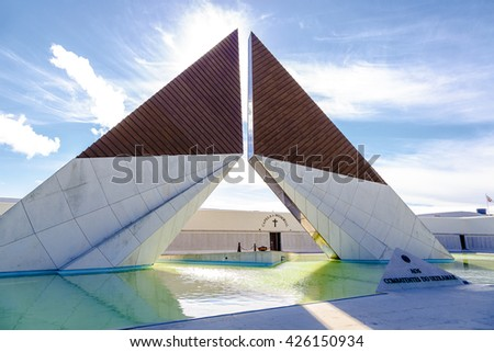 Lisbon, Portugal - March 19 , 2016: War Memorial on the banks of the River Tagus in Lisbon, capital of Portugal. Obelisk reflected in the smooth water of the pool - stock photo