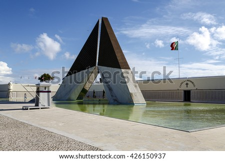 Lisbon, Portugal - March 19 , 2016: War Memorial on the banks of the River Tagus in Lisbon, capital of Portugal. Obelisk reflected in the smooth water of the pool