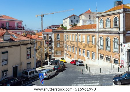 Lisbon, PORTUGAL -  MAY 18, 2016:  city street summer view with colorful houses, Portugal.