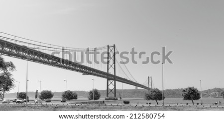 Lisbon, Portugal - May 15: 25th of April bridge in Lisbon on May 15, 2014. 25th of April bridge was originally named for Portugal's right-wing dictator, Antonio de Oliveira Salazar. Portugal, Europe. - stock photo