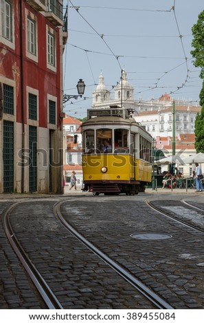 LISBON, PORTUGAL - MAY 15, 2015: Yellow tram running in Lisbon.