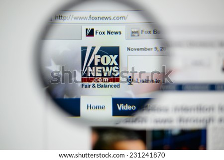 LISBON, PORTUGAL - NOVEMBER 17, 2014: Photo of Fox News homepage on a monitor screen through a magnifying glass.