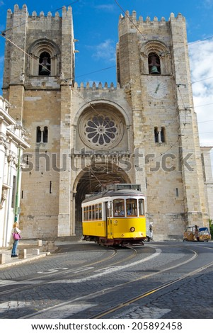 LISBON,PORTUGAL - NOVEMBER 18:vintage tram 28 in Alfama district on November 18,2013 in Lisbon, Portugal.The Lisbon tramway network operates since 1873, and presently comprises five urban lines. - stock photo