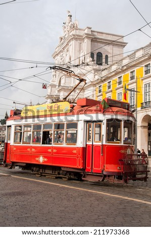 LISBON,PORTUGAL - OCT 25: Traditional tram at the Commerce square on October 25, 2013 in Lisbon, Portugal. The Lisbon tramway network operates since 1873.