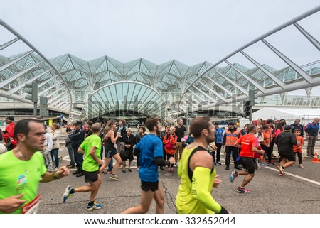 LISBON, PORTUGAL - OCTOBER 18, 2015: Participants at Lisbon marathon walking in Av. Dom Joao II in front of the famous and futuristic Oriente station. Lisbon Marathon is well known due to its - stock photo