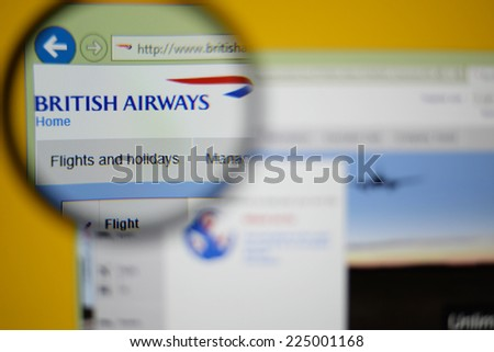 LISBON, PORTUGAL - OCTOBER 21, 2014: Photo of British Airways homepage on a monitor screen through a magnifying glass. - stock photo