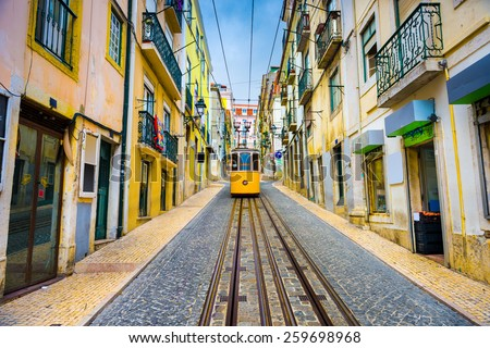 Lisbon, Portugal old town streets and tram. - stock photo