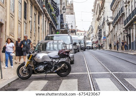 LISBON, PORTUGAL, on June 22, 2017. Historical buildings make attractive skyline in downtown. Cars stop on the beautiful street