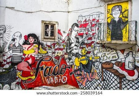 LISBON, PORTUGAL - SEPTEMBER 30: Graffiti in Lisbon depicting the Fado music genre on September 30, 2014 in Lisbon, Portugal.Traditional Portuguese music originating in 1820s. - stock photo