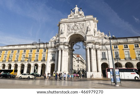 LISBON, PORTUGAL - September 25, 2015: The Rua Augusta Arch is a stone, triumphal arch-like, historical building and main attraction on the Praca do Comercio on September 25, 2015 in Lisbon, Portugal