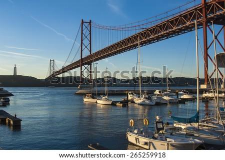 LISBON/PORTUGAL 4TH DECEMBER 2006 The Tagus River Bridge at Dawn - stock photo