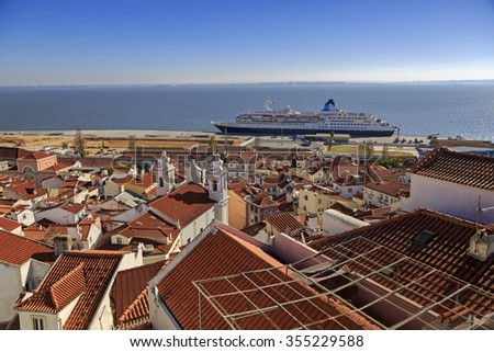 Lisbon roofs and cruise ship in harbor, top view  - stock photo